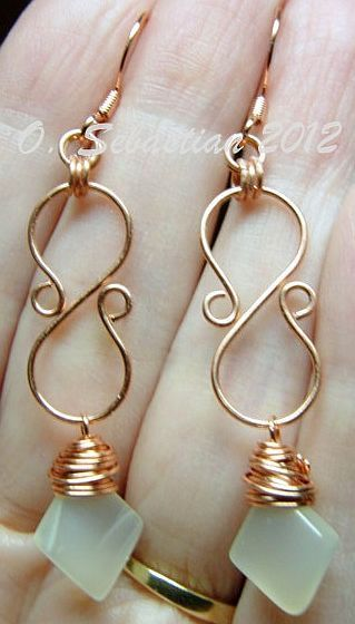 Wire s-shaped earrings. I'd use a different stone though