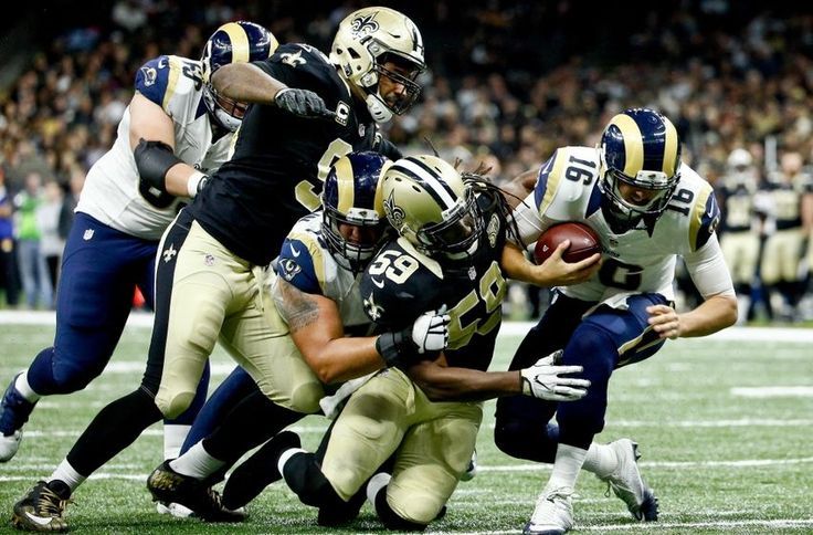 Nov 27, 2016; New Orleans, LA, USA; New Orleans Saints outside linebacker Dannell Ellerbe (59) sacks Los Angeles Rams quarterback Jared Goff (16) during the fourth quarter of a game at the Mercedes-Benz Superdome. The Saints defeated the Rams 49-21. Mandatory Credit: Derick E. Hingle-USA TODAY Sports