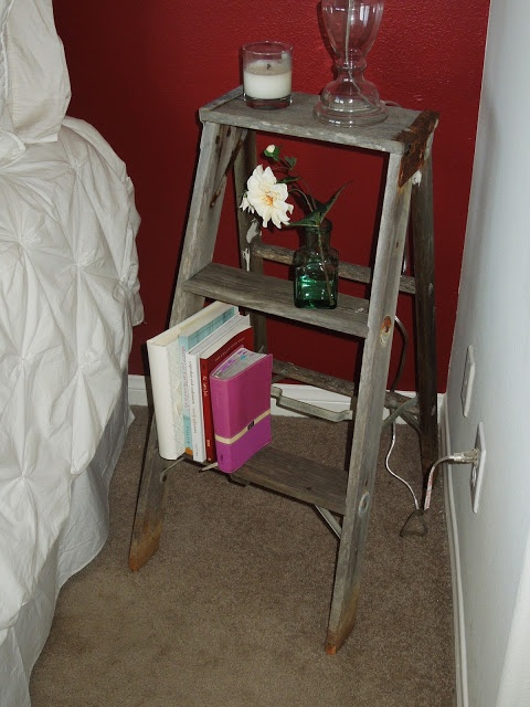 Would decorate a little differently but I love the idea of using a vintage step ladder as a small stand/shelf