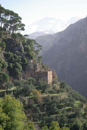 Lebanon, Qadisha Valley, Monastery Qannoubine and snowy mountain in the background