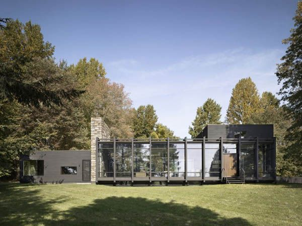 Dangle-Byrd House: Three interlocking volumes shape this glass, stone, steel and wood residence positioned within a forested five-acre property in Downingtown, Pennsylvania.