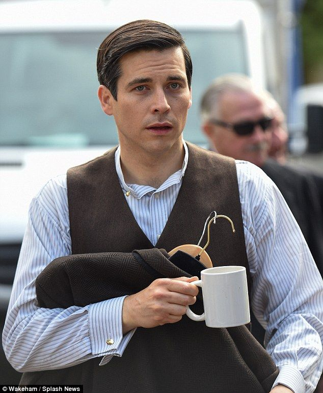 Working hard? Rob James-Collier led the way on the Downton Abbey set in Bampton, Oxfordshi...
