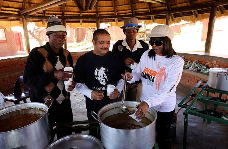 Mandela's birthday: Nelson Mandela's granddaughter Ndileka, right, serves soup in Mamelodi town