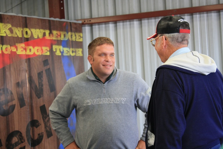 Agronomist Ryan Nickerson visits with a person who stopped by the Servi-Tech booth.