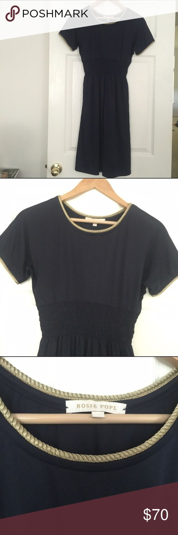 Rosie Pope Navy and Gold Maternity Dress Short sleeved dress with an elastic riches waist. It's navy with gold roping on the neckline and arms. This is one of my most favorite maternity dresses because you can wear it in any season. Looks great with heels, boots, sandals, flat and leggings. Rosie Pope makes beautiful pieces and this is no exception. Rosie Pope Dresses