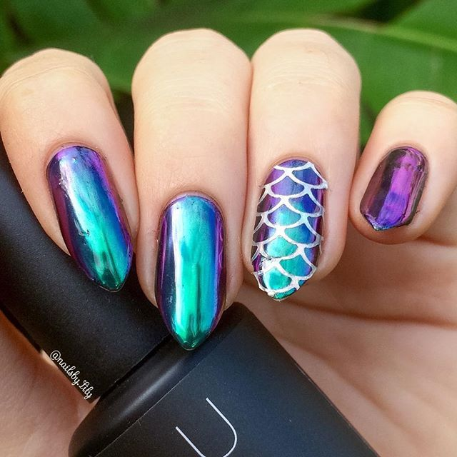 "You could say I'm a bit obsessed with multi chrome powder here's some multi chrome powder nails with a holo mermaid scale accent nail! (i know you can see the holo here but in the tutorial you will) to get this amazing multi chrome look I used ""mermaid bliss"" from @luxapolish along with their ""shiny no wipe top coat""! And I used holo mermaid scale vinyls from @bornprettystore  these are probably one of my favorite designs I've done yet! tutorial will be up soon!"