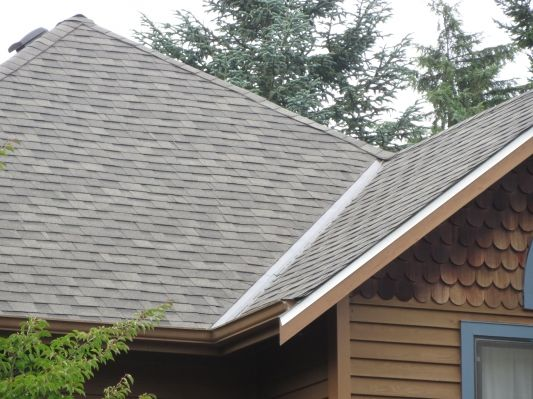 Why are composition roofs so popular for homes? Chinook Roofing's latest blog looks at durability, colors, and other features of this shingle that gets its strength from fiberglass. #CompositionRoofs