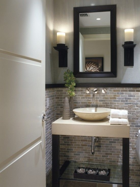 This small bathroom coveres the bottom half of the wall in a natural mosaic tile looks great Small half bathroom design ideas