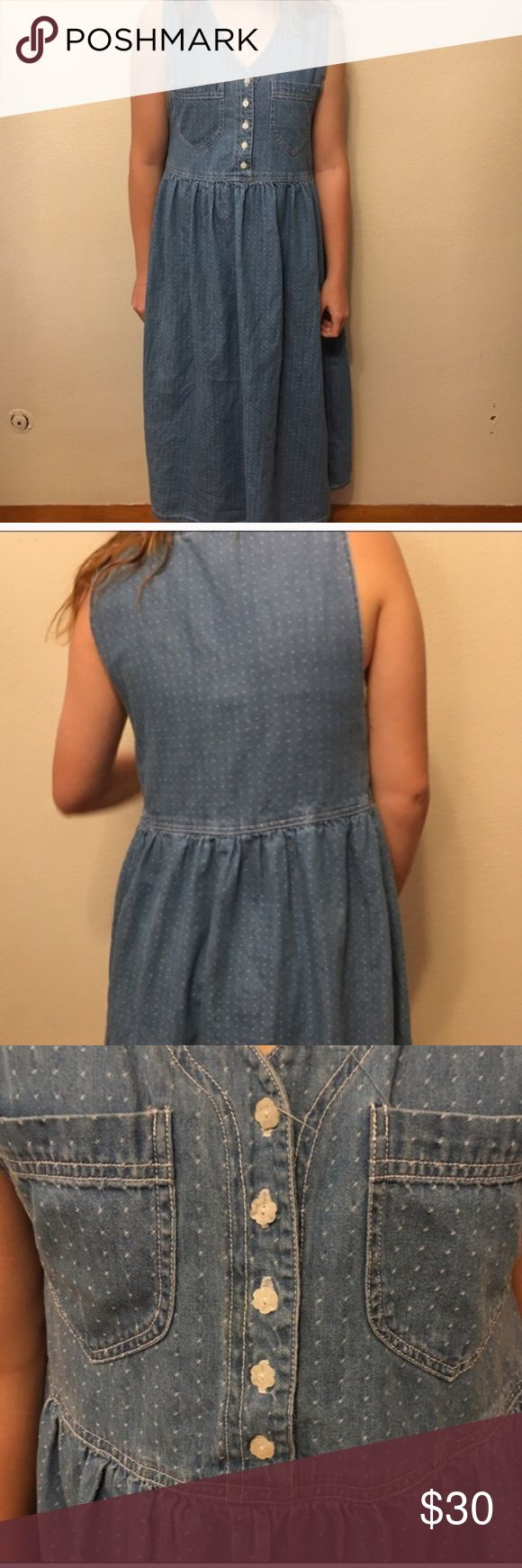 Vintage polka dot maxi jean dress medium Vintage polka dot jean dress. Has flower shaped buttons. 44 inches long. In good vintage condition. 100 percent cotton. Vintage , festival , recycle, denim. Perfect for fall. Vintage Dresses Maxi