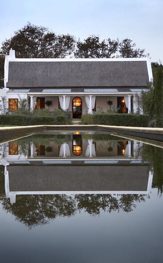 Hawksmoor House is a Cape Dutch country retreat located on a 220- hectare wine farm, Matjieskuil, near Stellenbosch in the Cape Winelands. Meticulously restored and beautifully decorated with a mix of modern furnishings and exquisite antiques, it occupies a stunning location amidst vineyards overlooking Table Mountain, and enjoys spectacular sunsets. Timbuktu Travel.