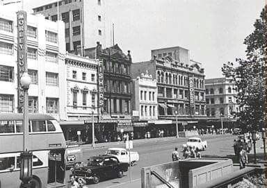 George St,Sydney opposite Town Hall Railway Station and St Andrew's Cathedral in 1960.Harolds at the right,with Morley Johnsons at the left (next to Babarfelds-not seen).A♥W
