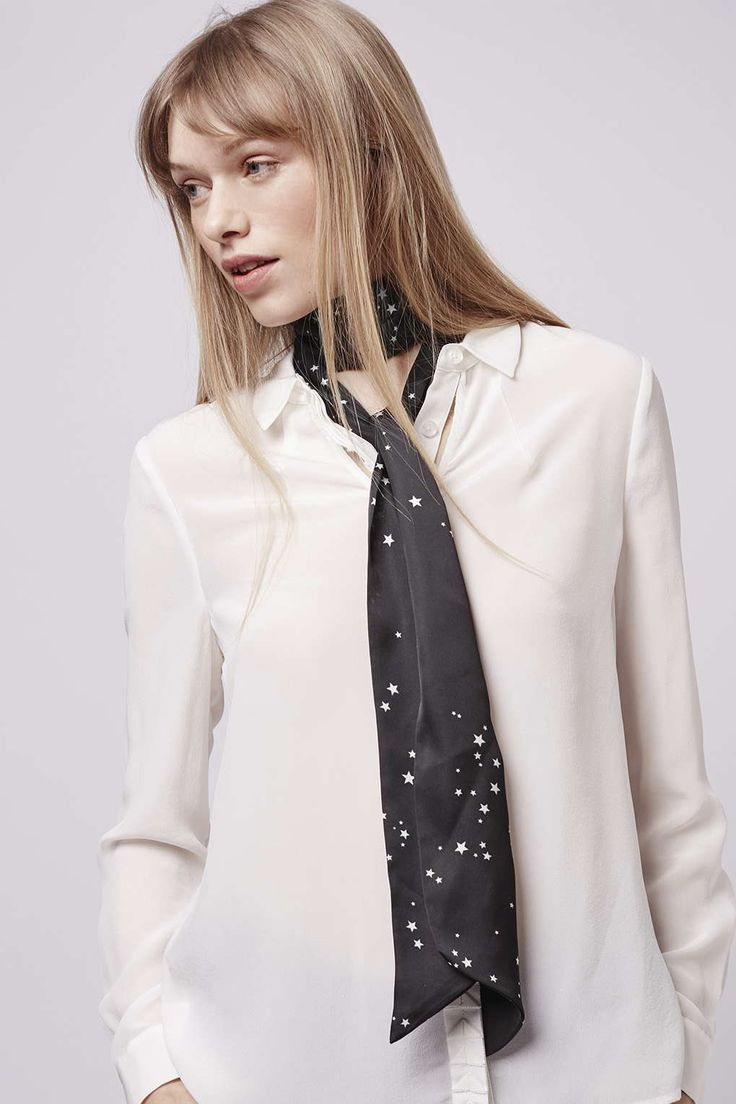 Do contemporary 70s styling with a skinny scarf, featuring a white star print, this will take your jeans and shirt combo through to evening effortlessly. #Topshop