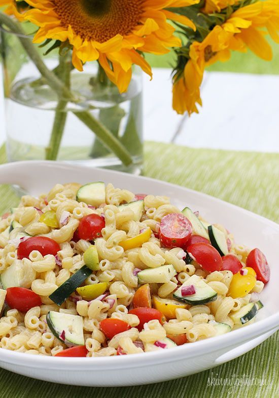 Summer Macaroni Salad with Tomatoes and Zucchini - Need a macaroni salad to bring to your next BBQ without tons of fat and calories? Look no further!