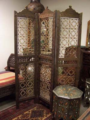 Moroccan room divider with iron filigree designs
