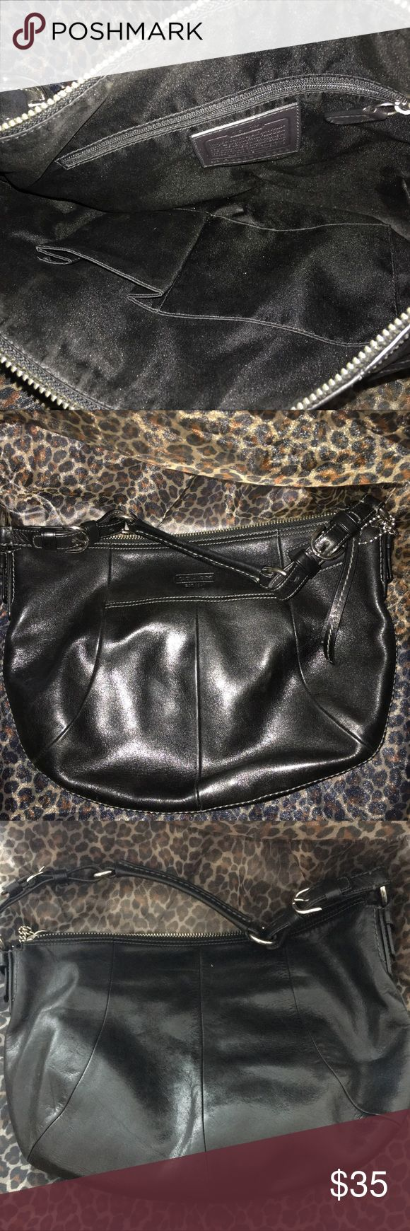 "Black Coach Purse March to the beat of your own drum with this beautiful gently used black Coach purse. Slight wear, but a fabulous day to evening bag.  Purse 10-14""pockets 7x7""; 6x8""; 5x5; 3x5 Strap 17"" Coach Bags"