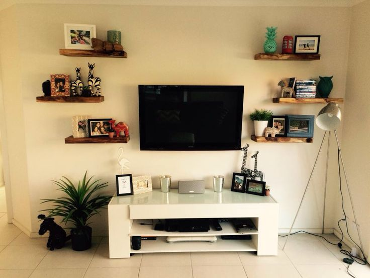 Recycled floating Norfolk pine shelves. Great feature point.