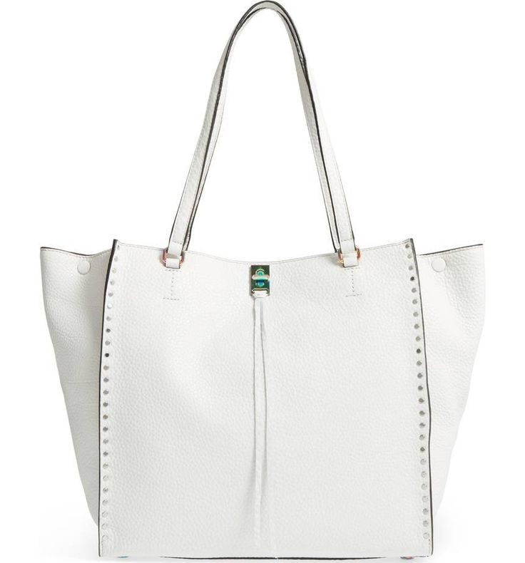 Smooth studs trace the flared-gusset silhouette of a scene-stealing tote in richly textured deerskin.