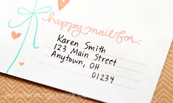 A cute little drawn bow across the envelope is a gorgeous touch.
