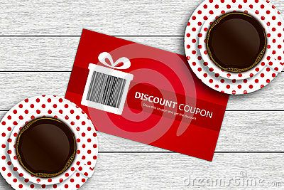 Discount coupon with two cups of coffee lying on wooden desk