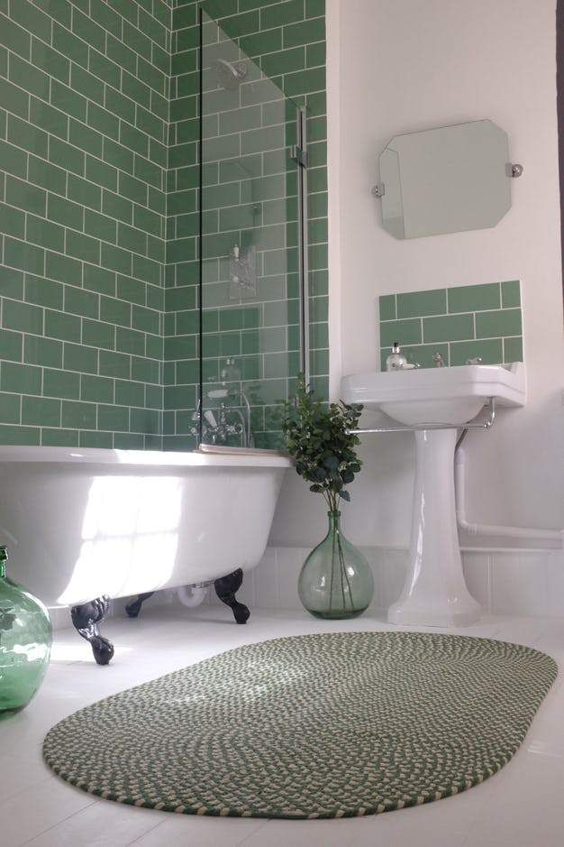 22 Ways To Work Sage Green Into Your Home Decor Asap Green Tile Bathroom Green Bathroom Ensuite Shower Room