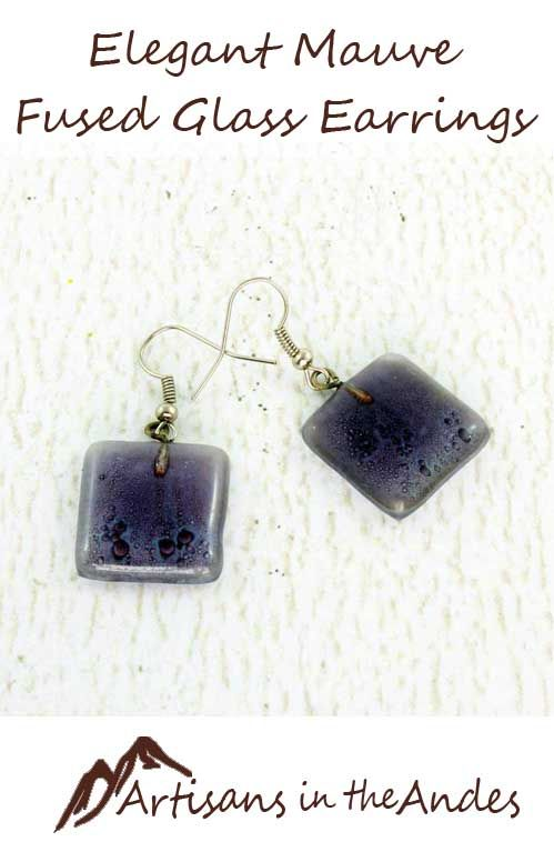 These simple elegant earrings will compliment your unique style with their wonderful understated color. The mauve purple also has grey and black tones for a rich look. The complexity of the color will allow you to wear these beaded earrings with a wide range of outfits. #fairtrade #fairtradefashion #fairtradejewelry #fairtradegifts