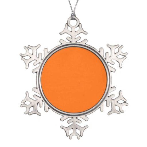 Sneeuwvlok met oranje vlak om eigen tekst en/of foto toe te voegen!