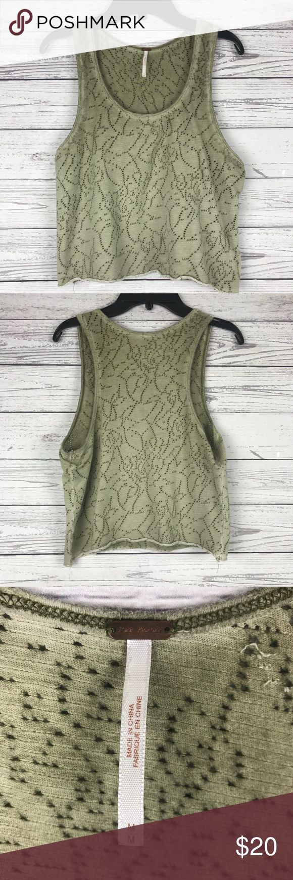 Free People Crop Top Perforated Distressed Design Free People Distressed crop top with perforated sleeveless design. Gorgeous neutral green which works well for all seasons. Size medium. Free People Tops Crop Tops