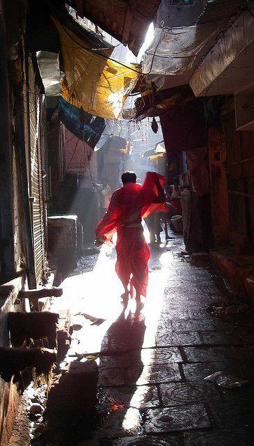 A holy man walks through the ancient city of Banares/Varanasi, India