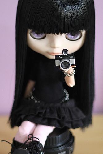 Fair face colour, dark hair and purple eyes.  Love it!