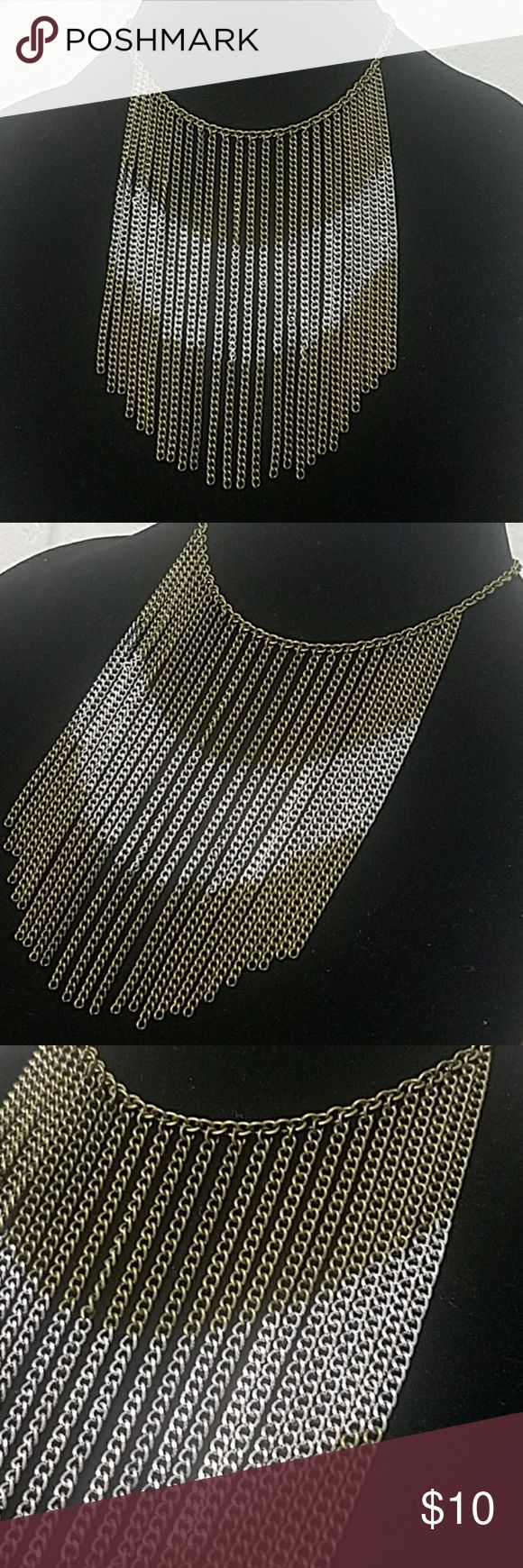 """Antiqued Brass Chevron Chain Collar 14"""" Antiqued brass chain w/lobster clasp closure.  26 (5"""") chains hang from along the necklace and have a chevron pattern in silver . Item#EN975 *ALL JEWELRY IS NWT/NWOT/UNUSED VINTAGE* 25% OFF BUNDLES OF 3 OR MORE ITEMS! ALL REASONABLE OFFERS ACCEPTED! BUY WITH CONFIDENCE TOP 10% SELLER  FAST SHIPPING, 5 STAR RATING, FREE GIFT w/MOST ORDERS! Jesi's Fashionz  Jewelry Necklaces"""