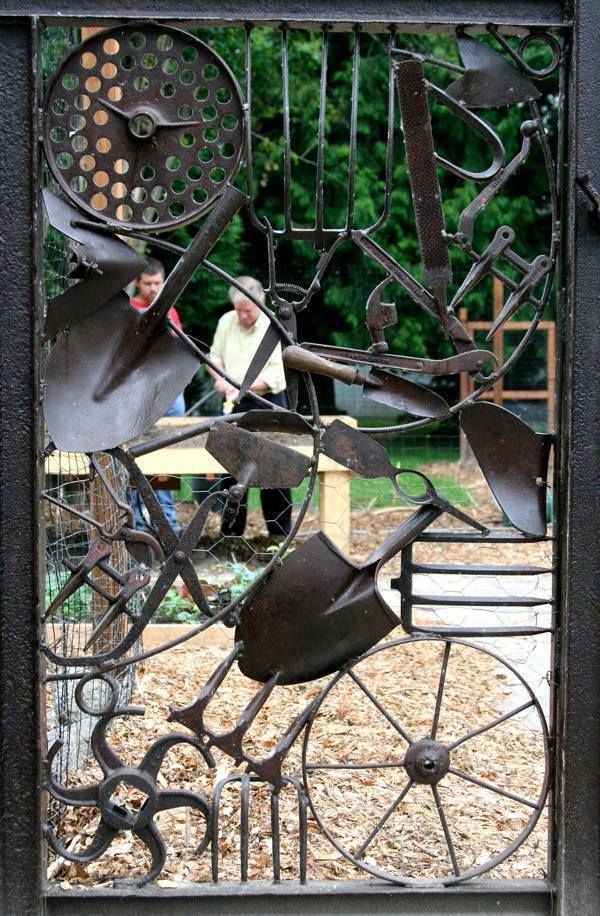 Beautiful garden gate.  Love all the unique pieces put together to make the gate.