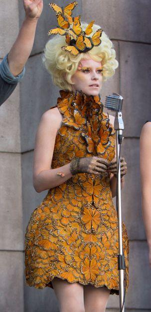 """Eyes bright, chins up, smiles on. I'm talking to you, Katniss."" - Effie Trinket takes Katniss and Peeta on the 74th Victory Tour."