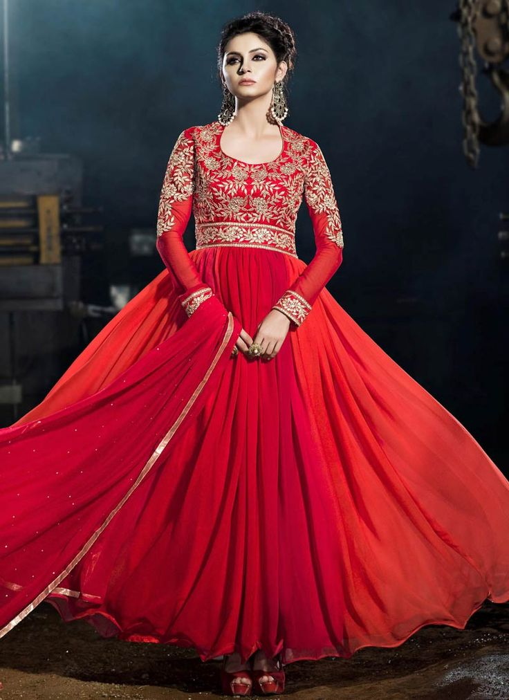 Make a strong style statement with this red ombre embroidered party wear #gown intricately designed with resham and zari work. It is paired with matching georgette duppata.This outfit can be stitched upto size 44. For stitching enquiries, please email us at customercare@hunardesigns.com  |…