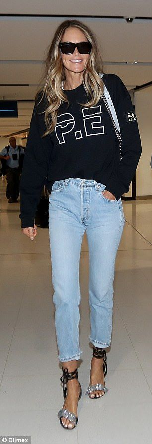 Elle Macpherson affectionately greets her father at Sydney airport