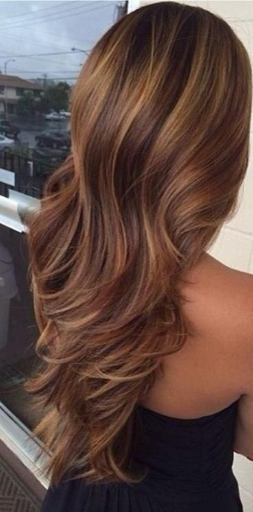 Beautiful Brunette Hair with highlights and Layers. Its hard to get highlights right for dark hair, but this looks great!