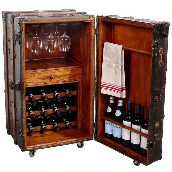Vintage steamer trunk transformed into a one-of-a-kind wine bar cabinet with plenty of storage space for wine bottles and wine glasses.