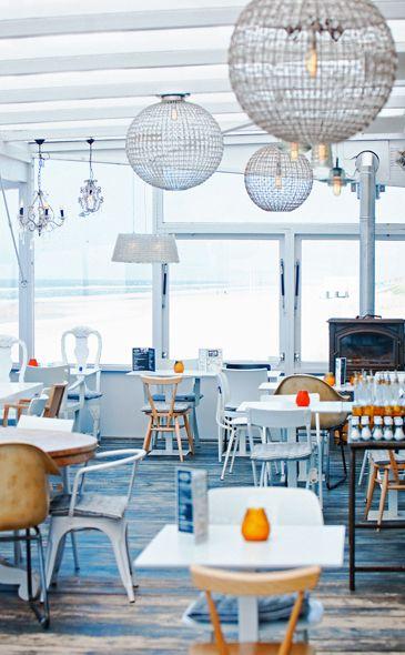 The strandpaviljoen Noord / Bergen / NL http://strandpaviljoennoord.nl/ Ball lamp, miw and match chairs.  Just the right touch of industrial  design White wood blue SB Nord >> Sissy-Boy
