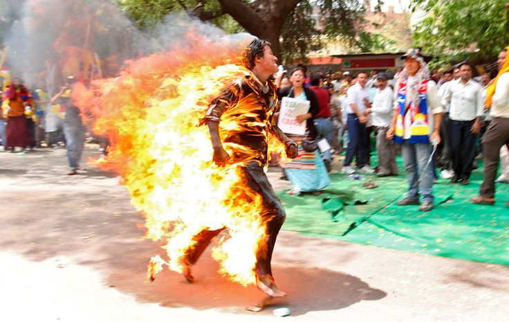 The man who set himself on fire for Tibet. A Tibetan exile runs through a street during a protest against the upcoming visit of Chinese President Hu Jintao.