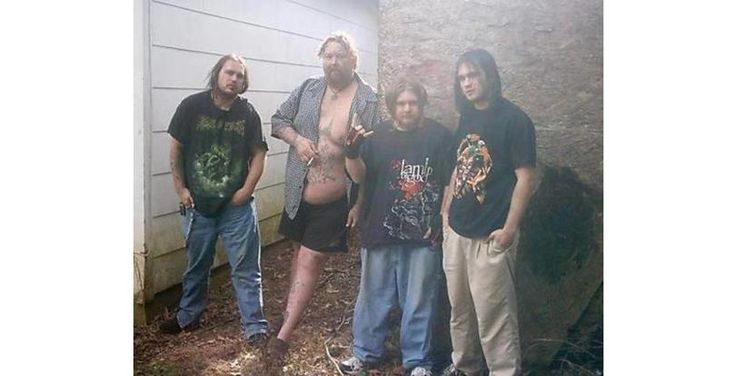 It looks like they went behind a bar to take a photo of the drunks who needed a smoke break.  42 Tragically Awkward Band Photos That Take Poor Taste To New, Impressive Levels (Slide #24) - Offbeat
