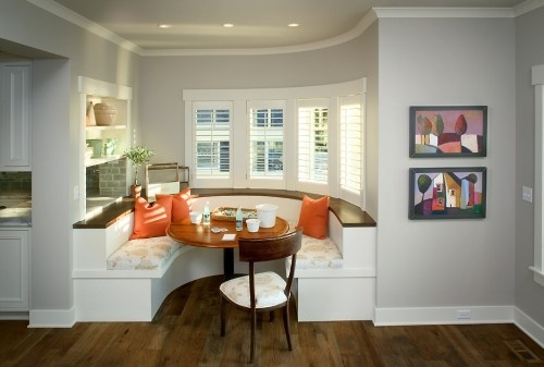A built-in booth designed for lounging and casual meals is tucked in next to the home's kitchen and main living areas. The curved booth can easily seat six, but if more space is needed, the table can be switched out and more chairs can be added.