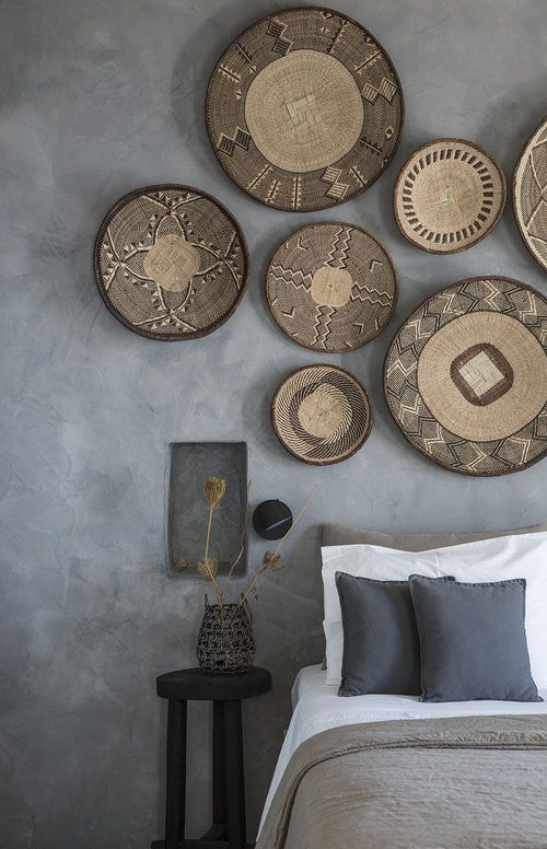 bedroom with grey walls and a collection of woven baskets used as