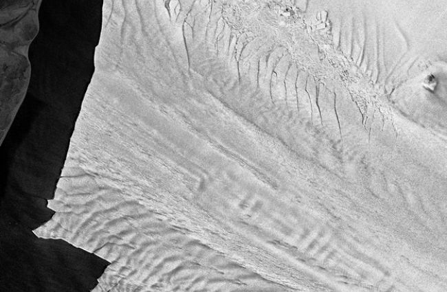 Massive Iceberg Breaks off Pine Island Glacier in Antarctica - An enormous slab of ice, about a quarter the size of Rhode Island and some 200 feet thick, has broken away from Antarctica, according to German researchers.