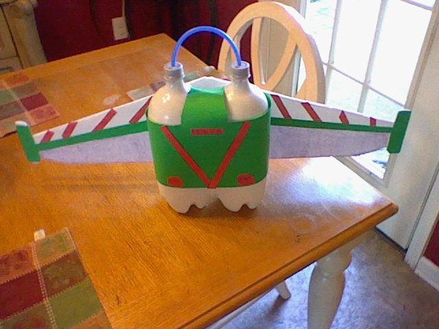 Homemade jet pack my husband and I made for our son, Riley's Buzz Lightyear costume. This jet pack was a hit.