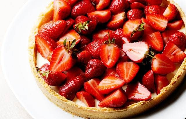 Strawberry tart: Strawberries are marinated in rosé wine, and served layered in a crumbly shortbread base with vanilla custard