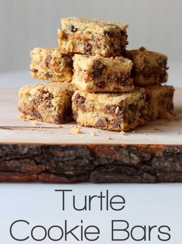 Don't be slow to grab your own - these turtle cookie bars will fly off the plate! Chocolate chips plus a caramel layer in the center makes these decadent cookie bars over the top!