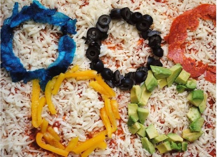 Olympic pizza: Jicama dyed blue is the secret to getting the complete Olympic rainbow on your pizza.