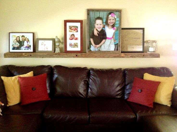 Long Wooden Shelf Above Couch Family Room