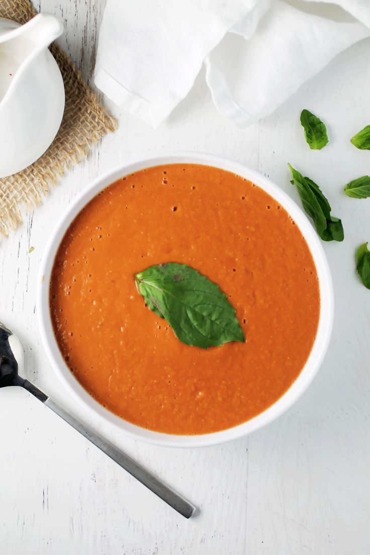 This easy Creamy Vegan Tomato Basil Soup recipe that is low fat, low calorie and a perfect simple clean cleanse lunch or dinner!