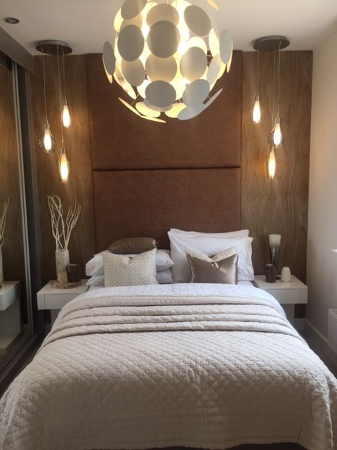 In the second bedroom of the Venice we've chosen a wood-effect textured  wallpaper and rich brown headboard, accented by warm lighting, ...