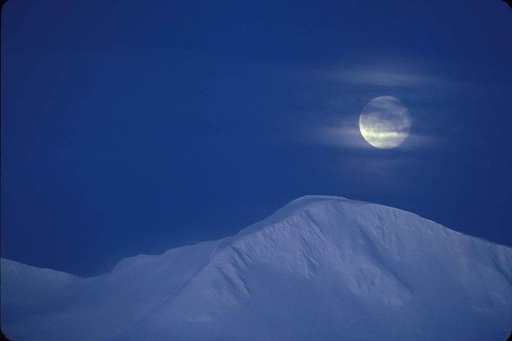 Moonrise over snow covered mountains.jpg